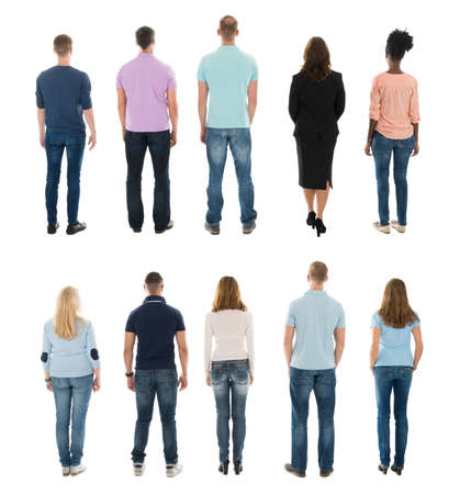 boys and girls: Rear View Of Creative People Standing In Row Against White Background