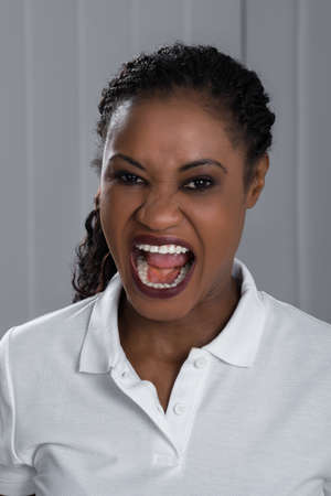 screaming: Portrait Photo Of Angry Young Woman Screaming
