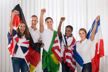 Patriotic Group Of Happy People Cheering With Flags From Different Nations Stock Photo