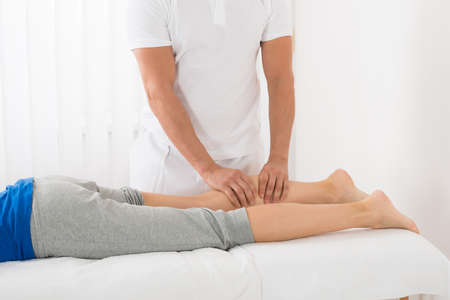 Close-up Of Man Giving Leg Massage To Woman In Spa Stock Photo
