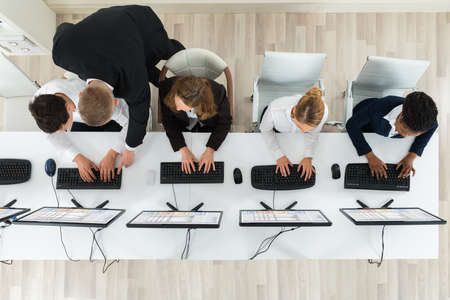 High Angle View Of Businesspeople Together Working In The Office Stock Photo