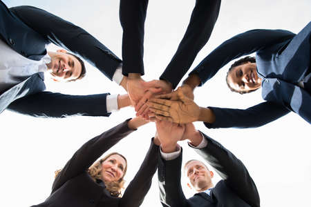 Low Angle View Of Multi-racial Businesspeople Stacking Hands Over Each Other Imagens - 57364052