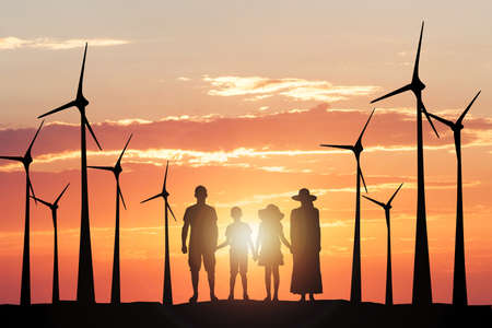 climatic: Silhouette Of A Family With Windmill Against Climatic Sky