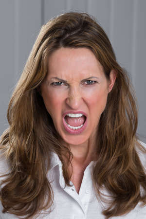 screaming: Portrait Photo Of Angry Mature Woman Screaming