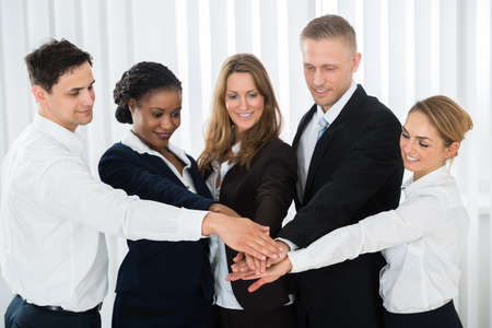 Group Of Multi-racial Businesspeople Together Stacking Hands Over Each Other