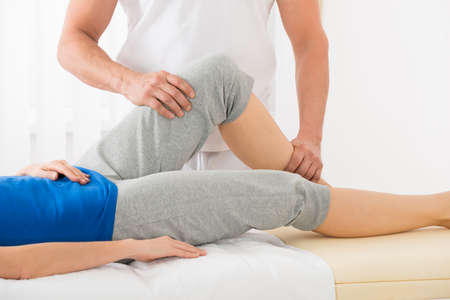 Close-up Of Therapist Hand Doing Knee Massage In Spa Saloon Stock Photo