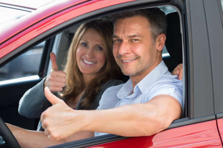 purchased: Close-up Of Happy Couple Sitting Inside The Newly Purchased Car Stock Photo