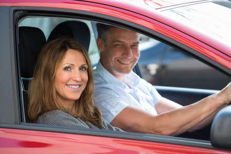 new car: Happy Mature Couple Sitting In New Car Stock Photo