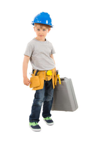 Portrait Of Boy Holding Toolbox Over White Background Stock Photo