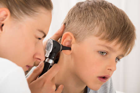 Close-up Of Female Doctor Examining Boys Ear With An Otoscope Reklamní fotografie