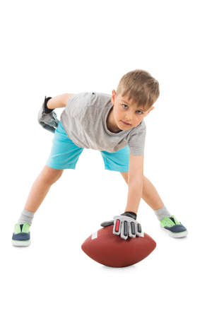 Portrait Of Boy Holding American Football Over White Background Stock Photo
