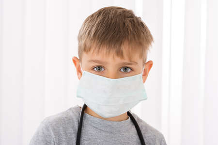 surgical mask: Portrait Of A Boy Doctor With Surgical Mask
