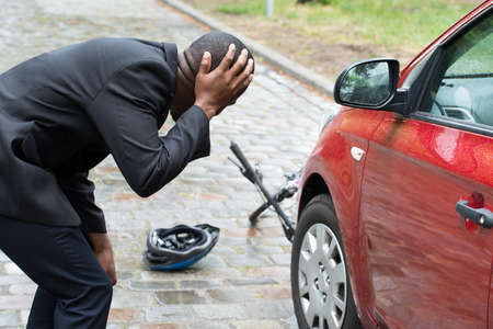 worried businessman: Shocked Male Driver With Hands On Head After Collision With Bicycle On Street Stock Photo