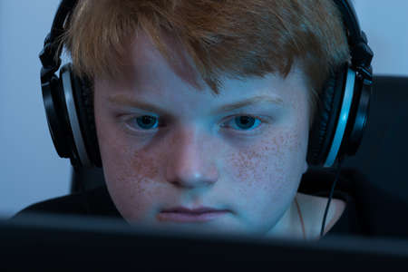 stolen identity: Close-up Of A Boy Working On Computer