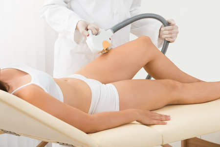 beauty center: Young Woman Receiving Laser Epilation On Beauty Center