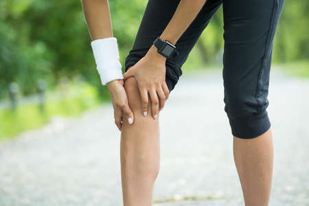 female jogger: Close-up Of Female Jogger Having Pain In Her Knee