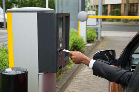 Person Sitting In Car Using Parking Machine To Pay For Parking Stock fotó