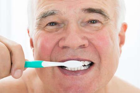 Senior Man Brushing His Teeth With Toothbrush Reklamní fotografie