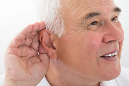 percept: Senior Man Trying To Hear With Hand Over Ear
