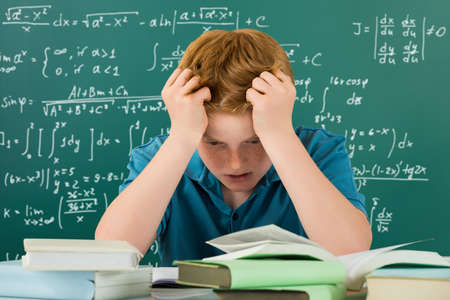 frustrate: Frustrated Boy In Classroom With Hands On Head