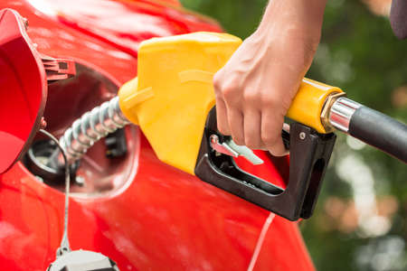 refueling: Close-up Of Businesswomans Hand Refueling Cars Tank