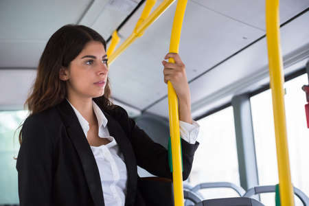 contemplated: Contemplated Young Businesswoman Traveling By Public Transport Stock Photo