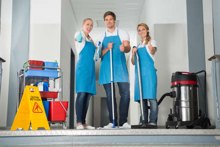 janitor: Group Of Happy Young Janitor With Cleaning Equipment Showing Thumbs Up