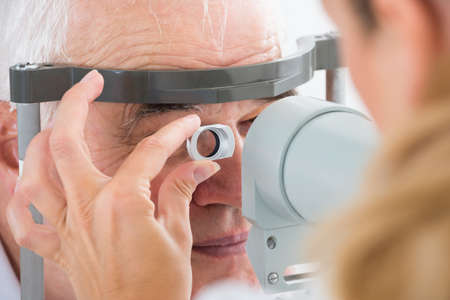 test equipment: Close-up Of Senior Man Checking Eyesight In Clinic