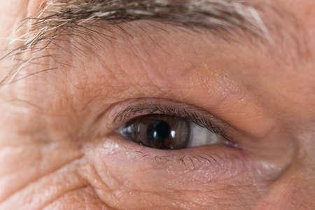 ageing: Close up Photo Of Senior Mans Eye