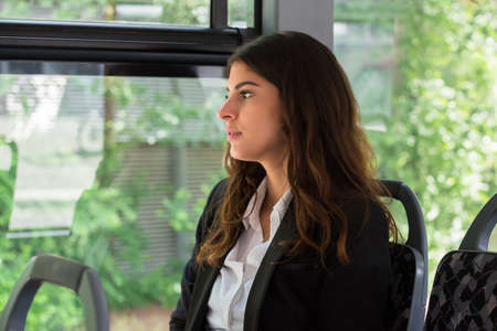 contemplated: Photo Of Contemplated Young Businesswoman Traveling By Bus