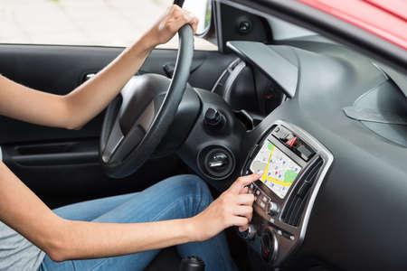 Woman Sitting Inside Car Using GPS Navigation