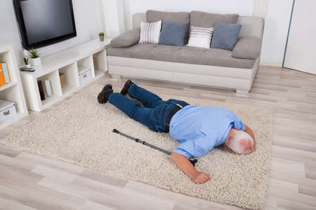 Unconscious Disabled Senior Man Lying On Carpet At Home
