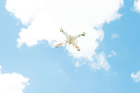 White Drone Quad Copter Flying In The Sky