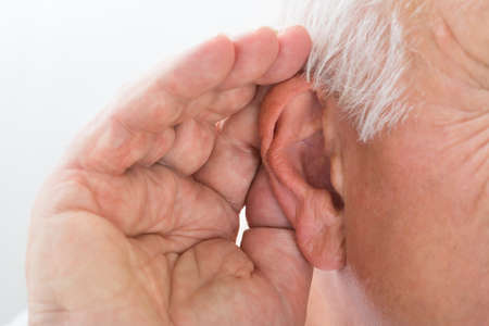 percept: Close-up Of A Senior Man Trying To Hear Hand Over Ear