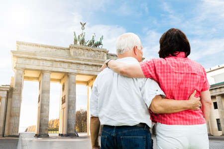 bond street: Rear View Of Senior Couple Standing In Front Of Brandenburg Gate Stock Photo