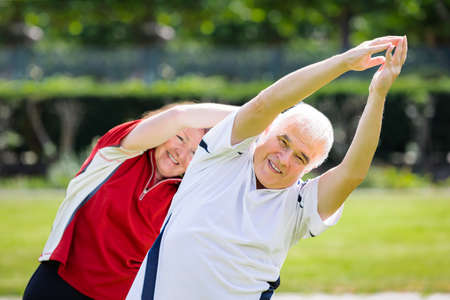 Photo Of Senior Couple Exercising Together At Park Stock Photo