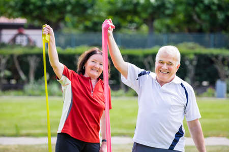 stretch: Happy Senior Couple Doing Work Out In Park