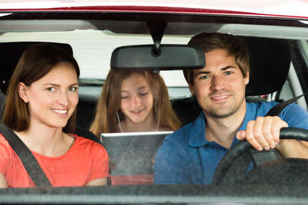 go inside: Happy Parent With Their Daughter Traveling By Car