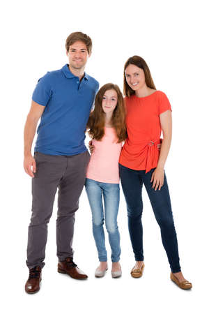 family isolated: Portrait Of A Happy Family Over White Background