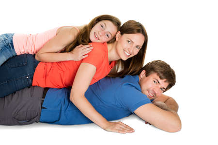 lying on side: Family Lying On Top Of Each Other Isolated On White Background Stock Photo