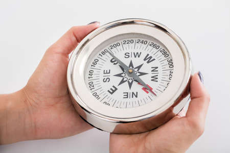guiding: Close-up Photo Of Person Hand Holding Compass