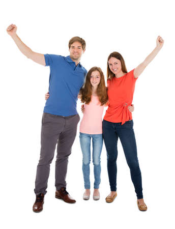 Happy Family Raising Their Arms Over White Background