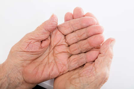 wrinkled: Close-up Of Senior Woman Hand On Desk