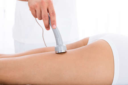 spa therapy: Close-up Of A Woman Getting Microdermabrasion Therapy On Her Legs In Spa Stock Photo