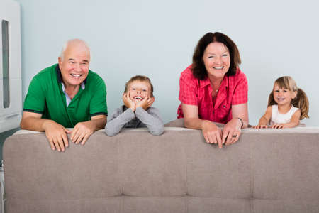 leaning: Family With Two Kids Leaning On Couch At Home