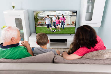 Family Watching Football Game On TV With Kids photo