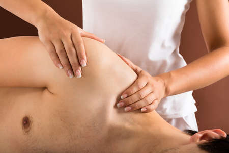 getting: Relaxed Young Man Getting Massage In Spa