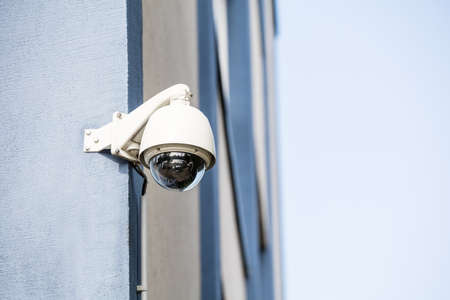 electronic survey: Close-up Of Security Camera Installed On The Wall Of The Building