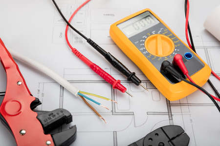 High Angle View Of Digital Multimeter On Blueprint With Red And Black Wire Stock fotó