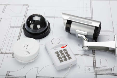 high angle view: High Angle View Of Security Equipment On Blueprint In Office Stock Photo
